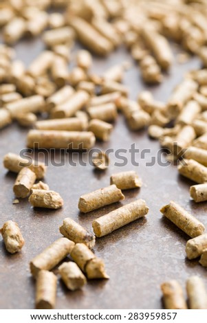 wooden pellets on old rusty background - stock photo
