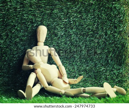Wooden people Show your love for each other In green grass  background   - stock photo