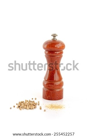 Wooden pepper mill, white pepper and pepper powder on white background.  - stock photo