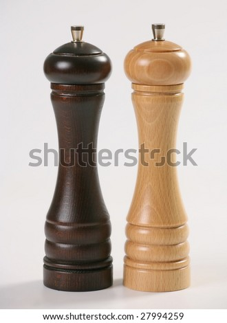 wooden pepper-mills - stock photo