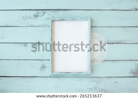 Wooden photo frame on mint shabby chic background - stock photo