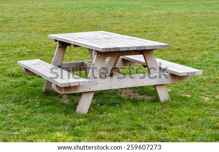 Wooden picnic table - stock photo