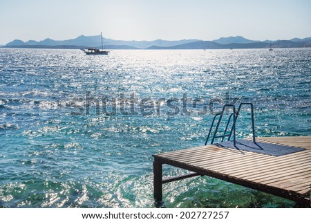 wooden pier and sea view in Turkey - stock photo