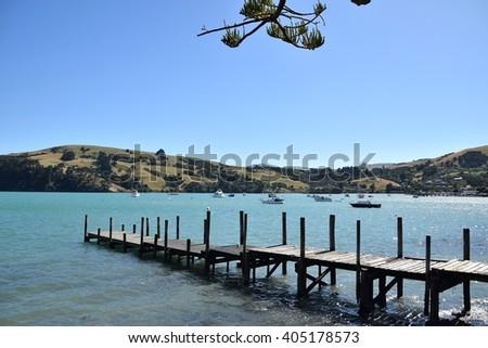 Wooden Pier at Scenic Akaroa. - stock photo
