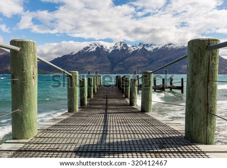 wooden pier by the lake - stock photo