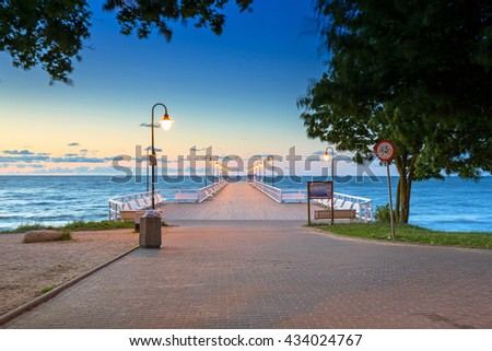 Wooden pier in Gdynia Orlowo at sunrise, Poland - stock photo
