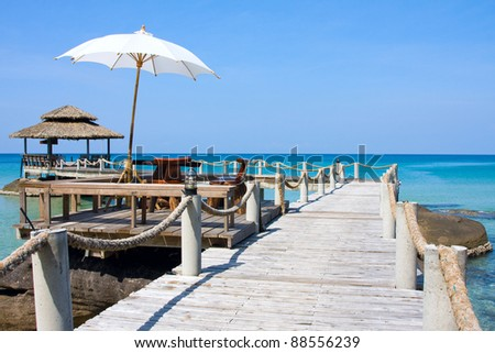 Wooden pier in tropical paradise , Koh Kood island , Thailand - stock photo