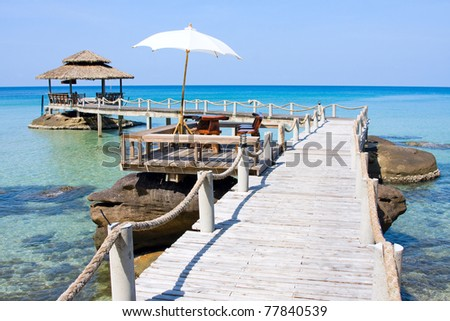 Wooden pier in tropical paradise, Kood island, Thailand - stock photo
