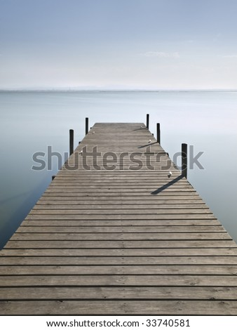 Wooden pier on a lake - stock photo