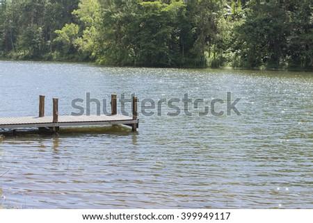 wooden pier on lake - stock photo