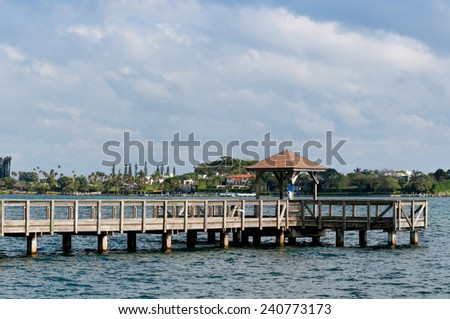 Wooden pier with a gazebo - stock photo
