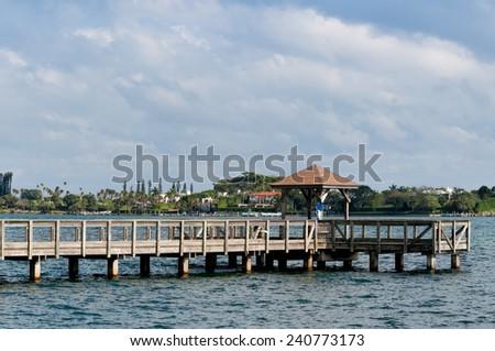 Wooden pier with a gazebo - stock photo