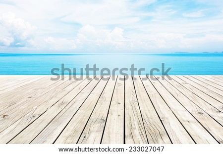 Wooden pier with blue sea and sky background  - stock photo