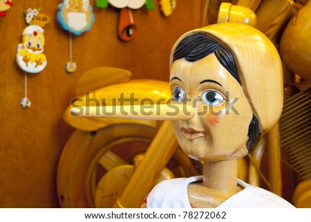 Wooden Pinocchio doll with long nose - stock photo