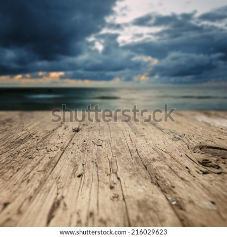 Wooden planks on the beach - stock photo