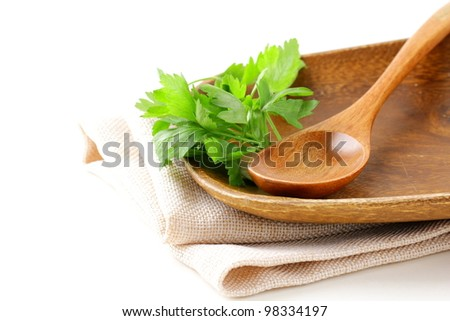 wooden plate and cutlery on a white background - stock photo