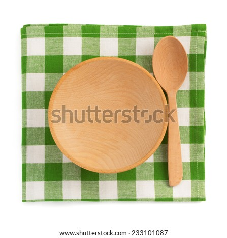 wooden plate at checked napkin on white background - stock photo