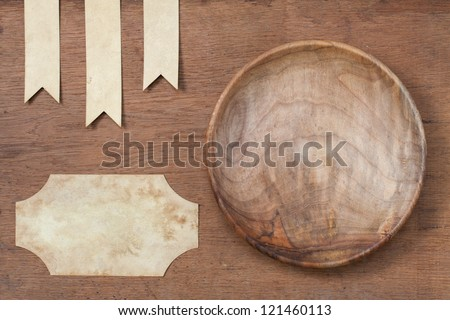 Wooden plate, paper labels on oak wood texture background - stock photo