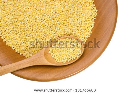 wooden plate with beans and millet on white background with clipping paths - stock photo