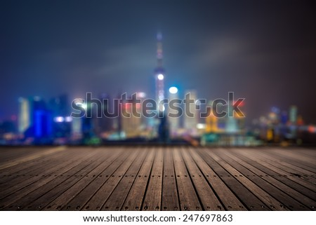 wooden platform and lights of night,shagnhai china. - stock photo