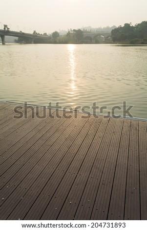 Wooden platform in morning mist - stock photo