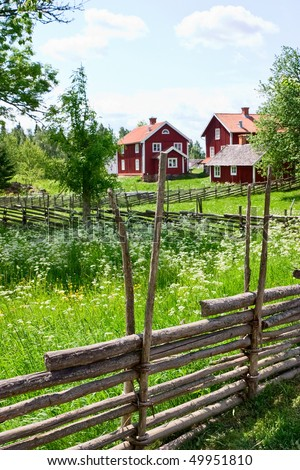 Wooden pole fence in a country landscape - stock photo