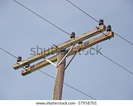 wooden pole for electrical transmission and wires - stock photo