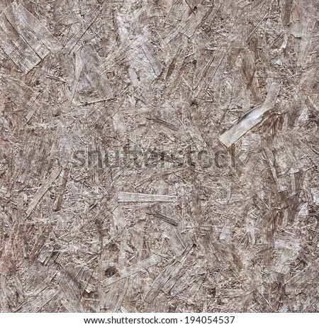 Wooden Pressed Panel (pressed wooden waste). Background and seamless texture. - stock photo