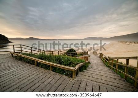 Wooden promenade with a beautiful view of San Jorge beach, Ferrol, Galicia, Spain, - stock photo