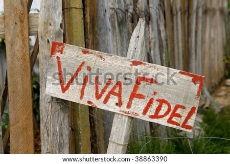 "Wooden propaganda sign ""Viva Fidel"" in Cuban countryside - stock photo"