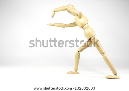 Wooden Puppet doing Sportive Lessons - stock photo