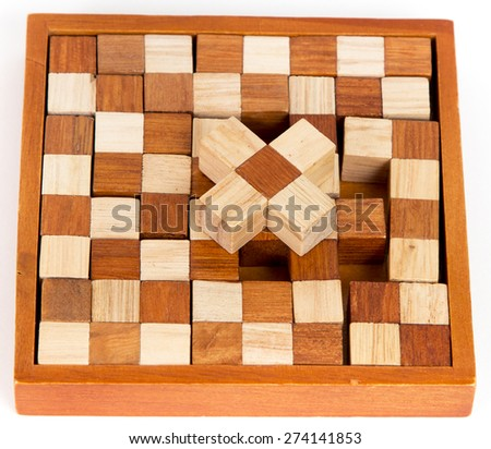 wooden puzzle, isolated imagecomposite wooden figures for the development of logical thinking. - stock photo