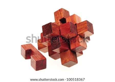 wooden puzzle over white background - stock photo