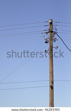 wooden pylon with wires - stock photo