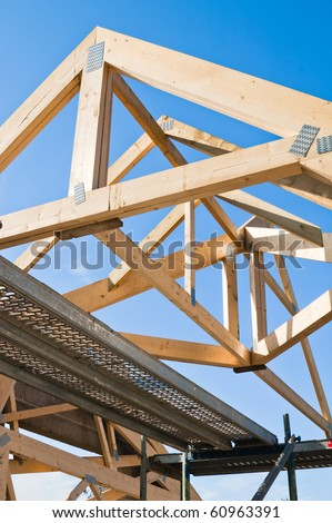 Wooden rafters against the blue sky - stock photo