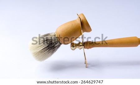 Wooden razor holder and shaving brush set. Shot using natural light. Slightly defocused and close-up shot. Copy space. - stock photo