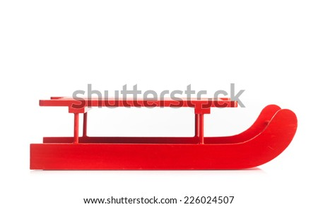 Wooden red sled isolated on white background - stock photo