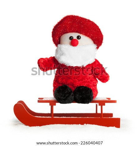 Wooden red sled with Santa Claus plush on white background. - stock photo