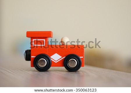 Wooden red toy train on table - stock photo