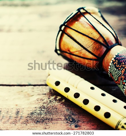 Wooden reed pipes and drium on wooden background  - stock photo
