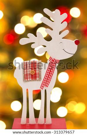 Wooden reindeer over bokeh background - stock photo
