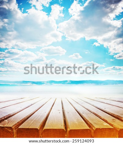 wooden retro deck and blue sky and sea/ Summer holidays background - stock photo