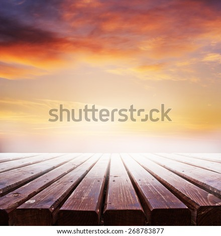 wooden retro deck and sunrise or sunset sky/ Summer holidays background - stock photo