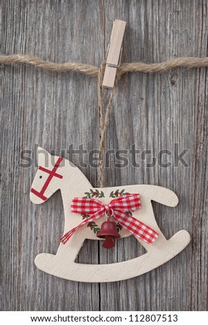 Wooden rocking horse over wooden background - stock photo