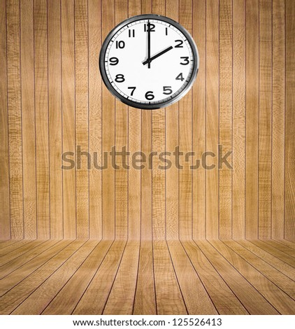 Wooden room with clock - stock photo