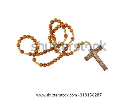 Wooden rosary with a cross isolasted on white background - stock photo