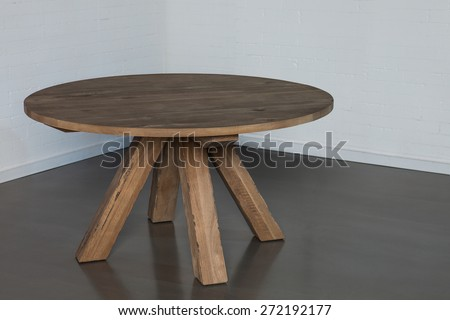 Wooden round table isolated - stock photo