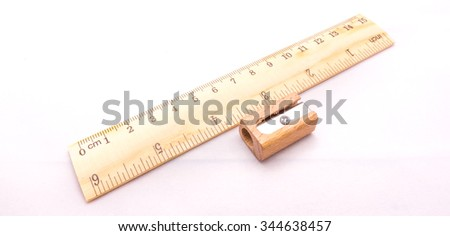 wooden ruler and sharpener - stock photo