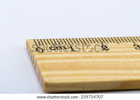 Wooden rulers over a white background - stock photo