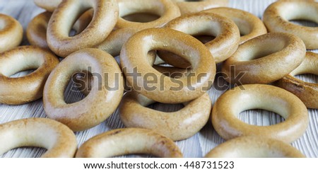 Wooden rustic table with a group of small dry russian national bagels - stock photo